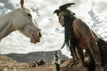 Tonto looks at his magical horse in The Lone Ranger
